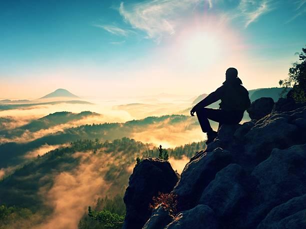 Hiker man take rest on mountain, lay on summit, stock photo