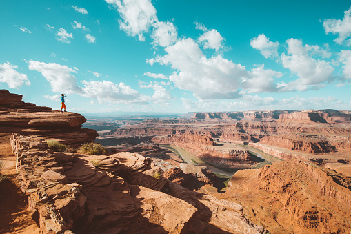 Hiker on a cliff in Dead Horse Point State Park, Utah, USA