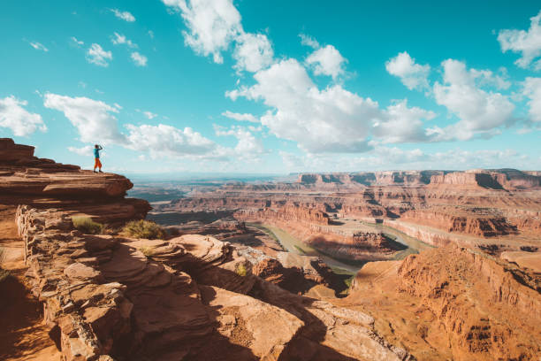 Hiker on a cliff in Dead Horse Point State Park, Utah, USA stock photo