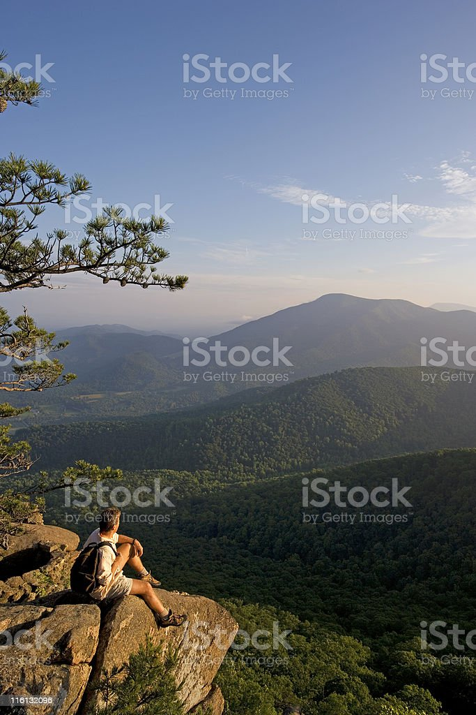 Hiker On A Ledge In Blue Ridge Mountains stock photo