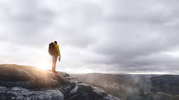 Hiker on a mountain at sunrise picture id1046680200?b=1&k=6&m=1046680200&s=612x612&w=0&h=8wvy kdifakamyuwxu6vyxbrkg8fngv tici8ngxrbe=