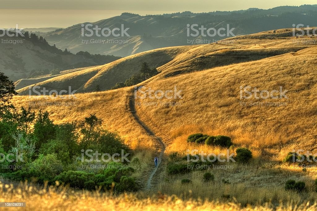 Hiker on a trail. HDR Photo royalty-free stock photo