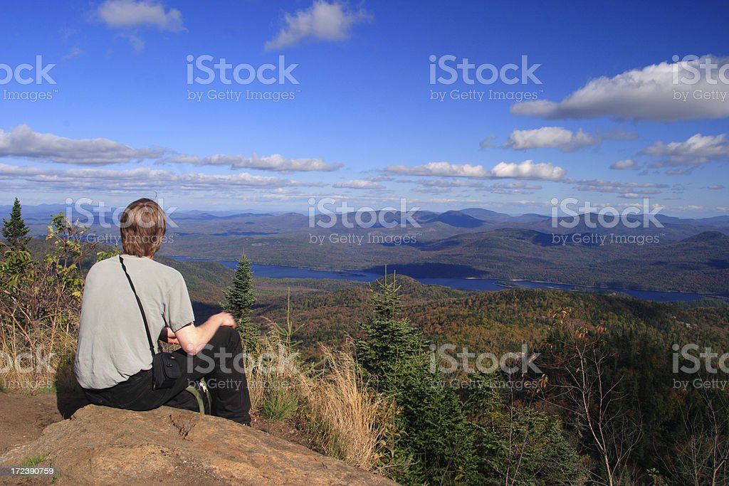 hiker on mountain peak royalty-free stock photo