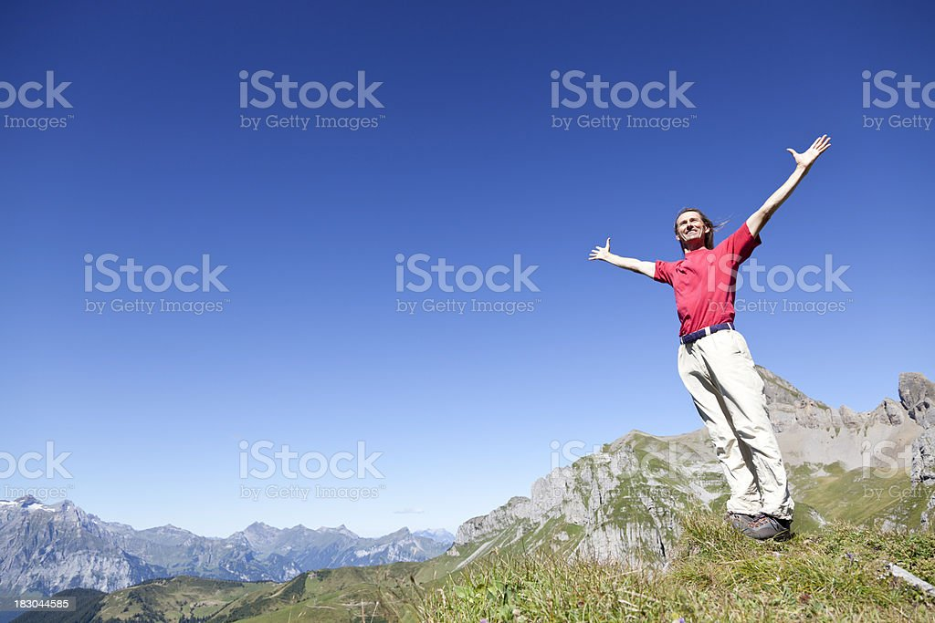 Hiker on Mountain with Outstreched Arms for Positivity Freedom royalty-free stock photo