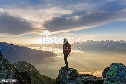 istock Hiker on mountains enjoy sunrise 582272330