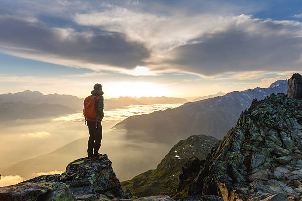 hiker on mountains enjoy sunrise - mountain stock photos and pictures