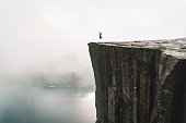 Pulpit rock - Preikestolen - Norway. Walking routes, exploration and activities of tourists, mountaineers and travelers. Tourist attraction. Crowds of tourist go on a hike to reach the rock.