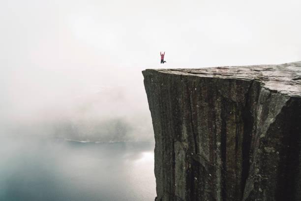 Hiker on Pulpit rock - Preikestolen stock photo
