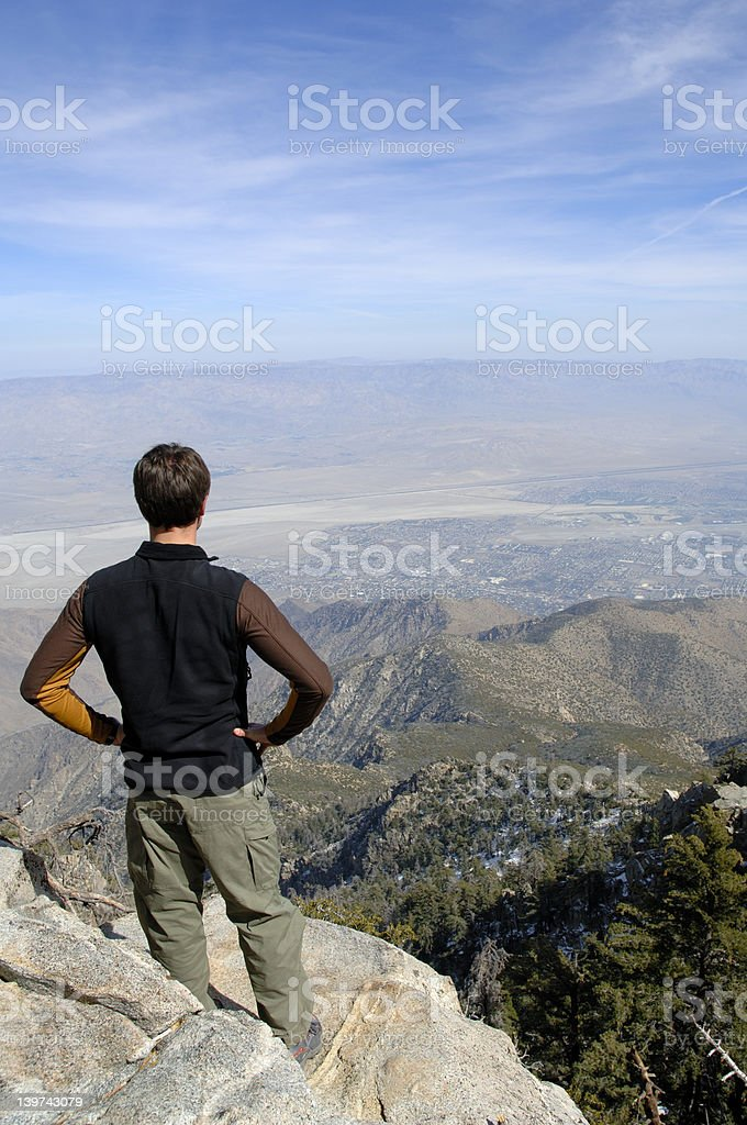 Hiker on summit royalty-free stock photo