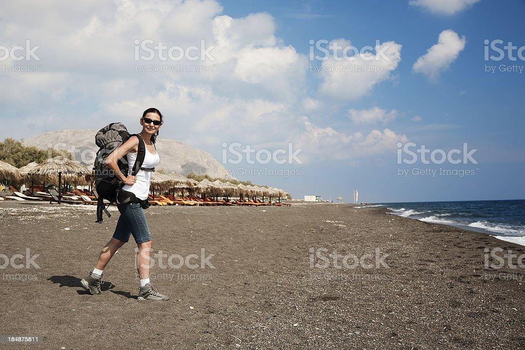 Hiker on the beach stock photo