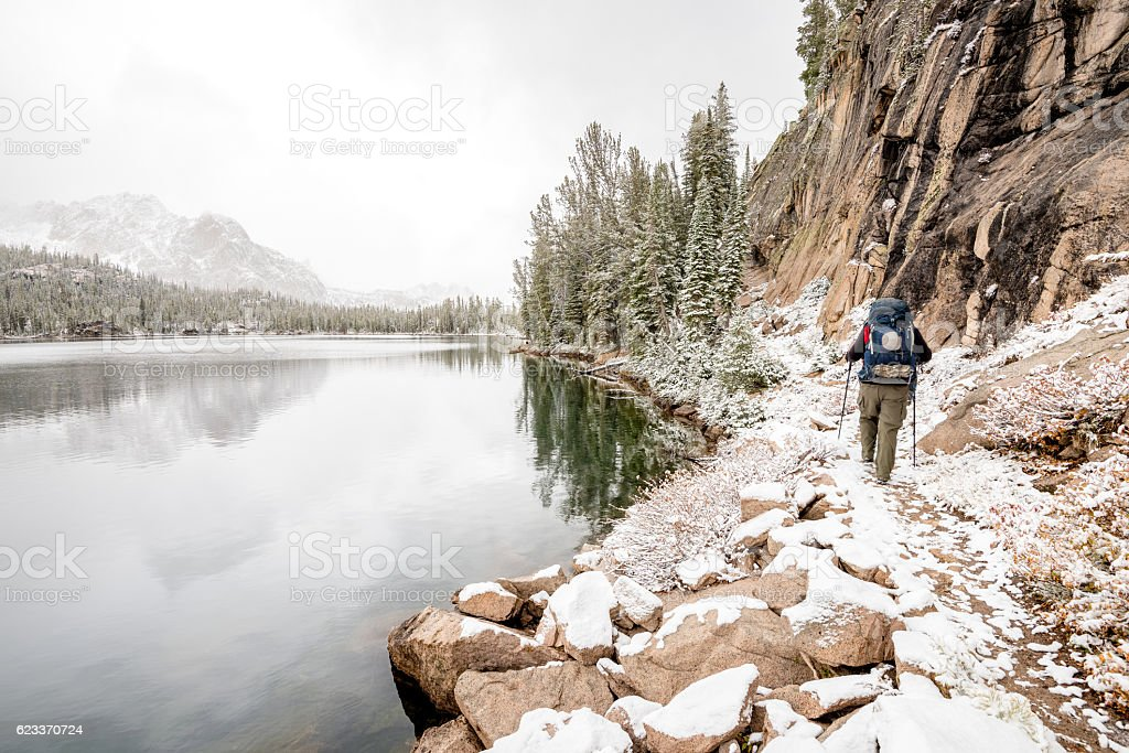 Hiker on the move Idaho mountain lake stock photo