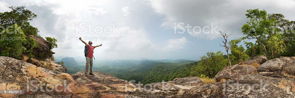 Hiker on the rock stock photo