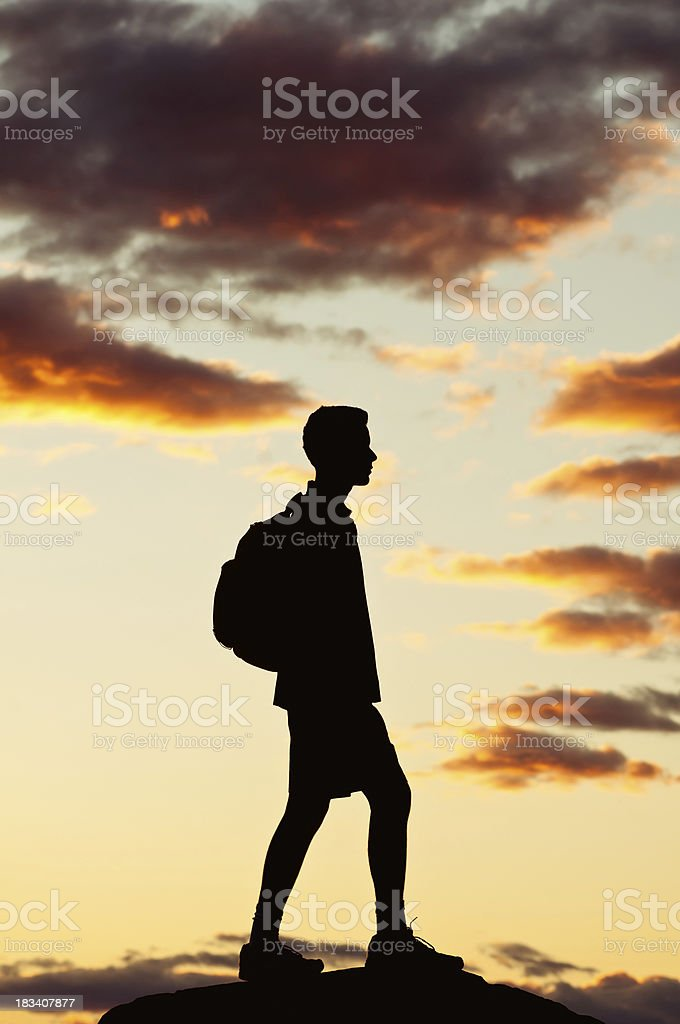 Hiker on the top of mountain, after sunset - II royalty-free stock photo