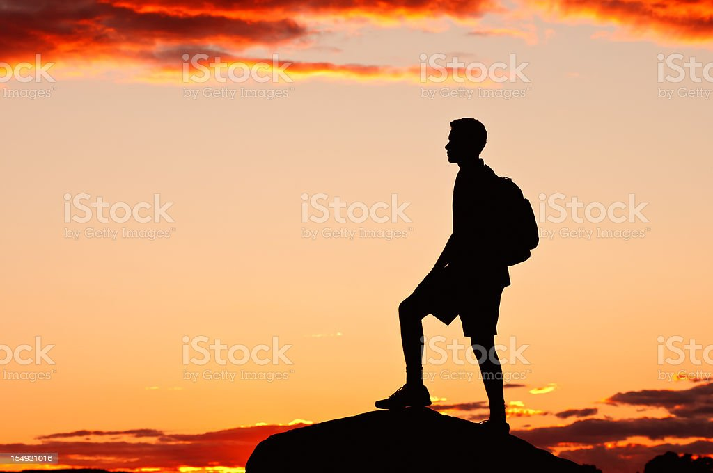 Hiker on the top of mountain, after sunset - IV royalty-free stock photo