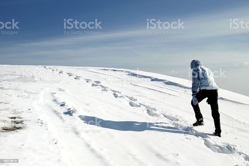 hiker on the winter snow field royalty-free stock photo
