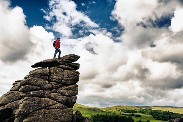 hiker on top of a rock - outcrop stock pictures, royalty-free photos & images