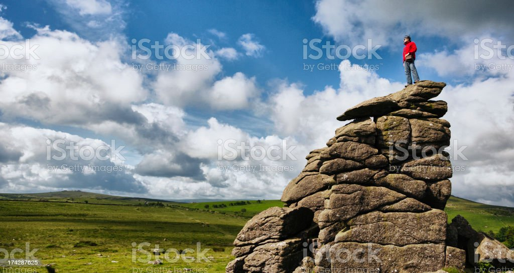 Hiker on top of a Rock stock photo