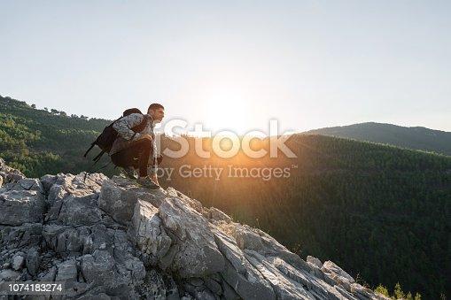 Hiker on top of mountains enjoy sunrise