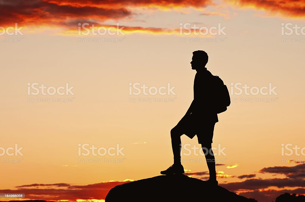 Hiker on top of the mountain after sunset - IX stock photo