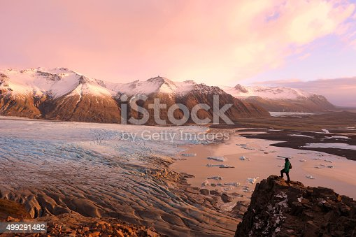istock Hiker on Top of the Mountain Overlooking Skaftafell Glacier Iceland 499291482