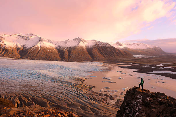 Hiker on Top of the Mountain Overlooking Skaftafell Glacier Iceland stock photo