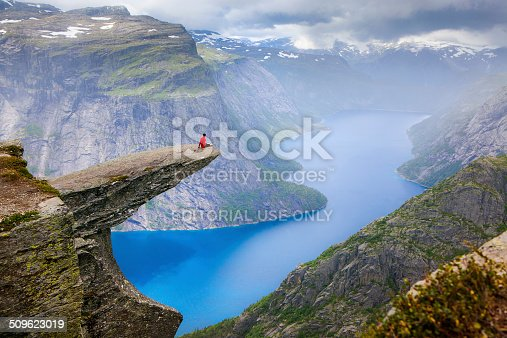 Trolltunga, Norway - july 30, 2014: Trolltunga rock with a characteristic shape located in Norway on the border of the Hardangervidda plateau, close to the town Tyssedal. It is a popular tourist attraction in Norway and heavily visited by tourists during the summer months.