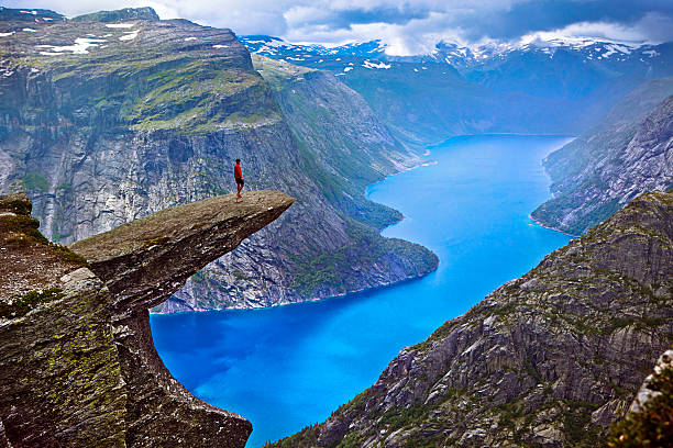 hiker on trolltunga - fjord stock photos and pictures