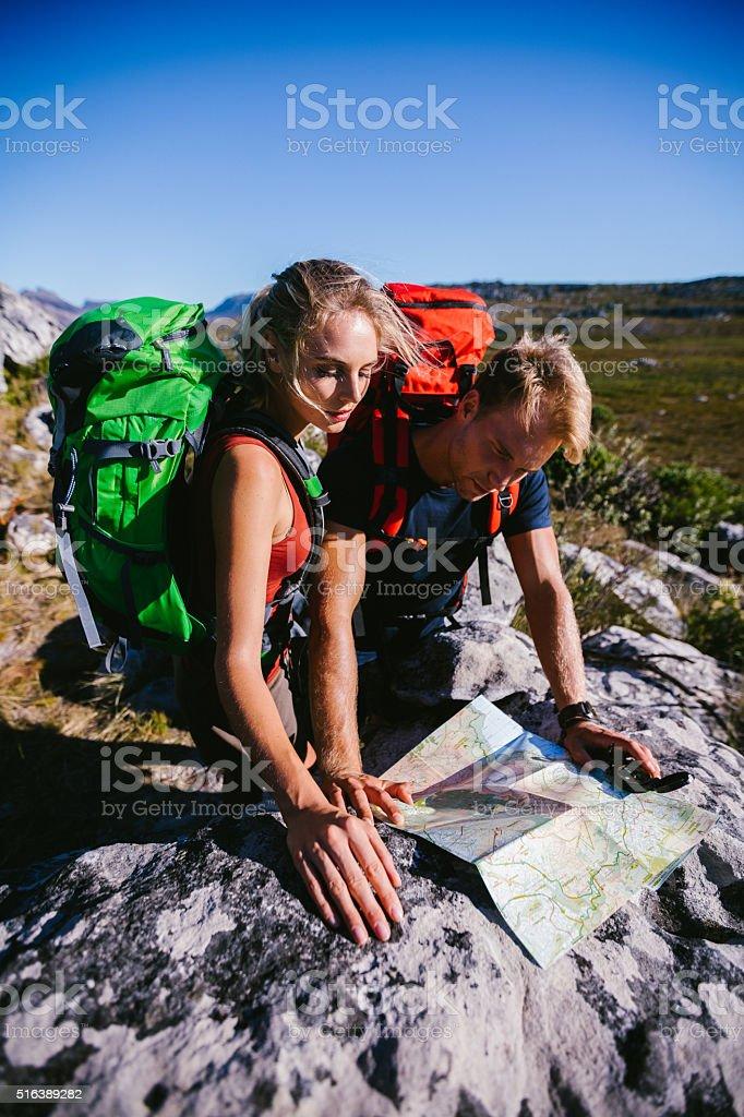 Hiker orienteering on outdoor trekking adventure with map and co stock photo