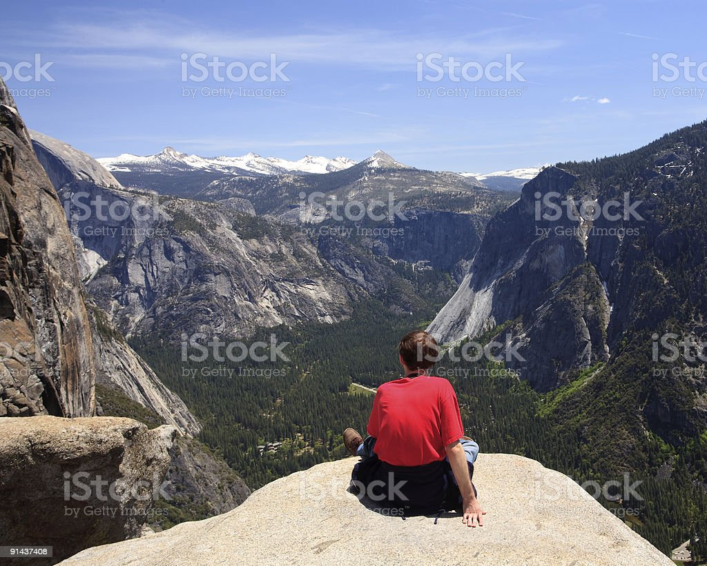 Hiker overlooking Yosemite view royalty-free stock photo