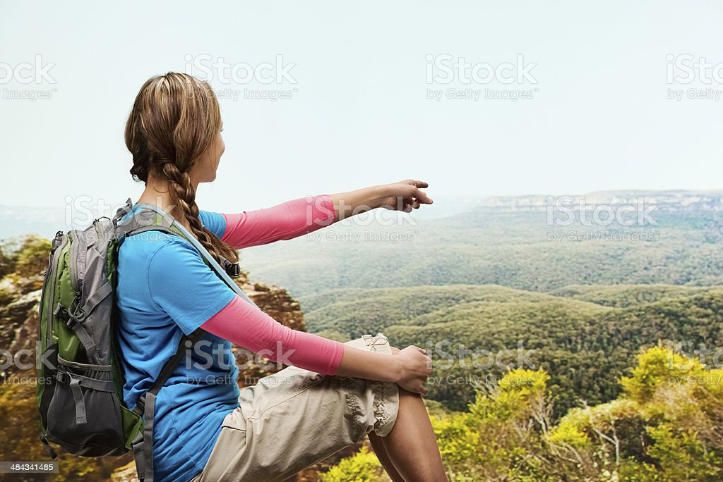 Hiker pointing away stock photo