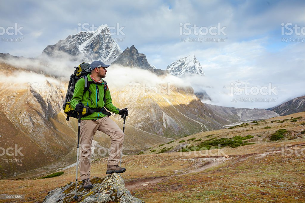 Hiker posing at camera on the trek in Himalayas, Nepal stock photo