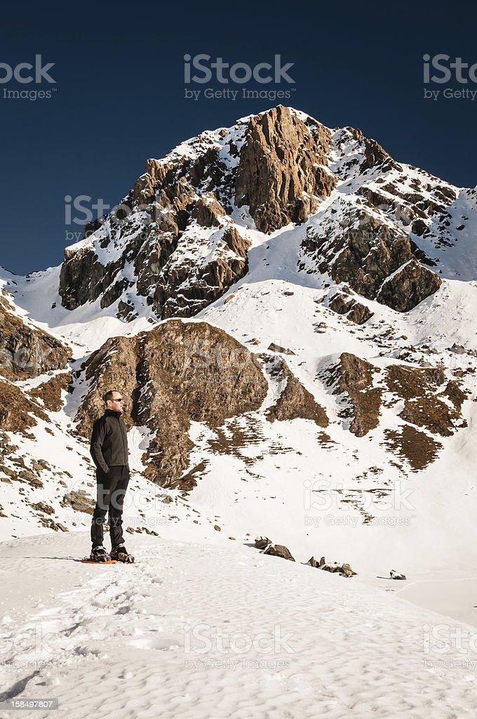 Hiker Posing Under Mountain Peak royalty-free stock photo