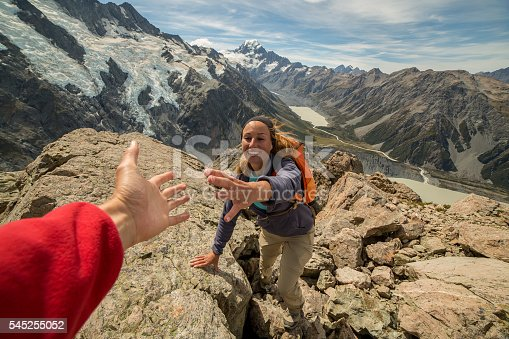 istock Hiker pulls out his hand to get assistance from teammate 545255052