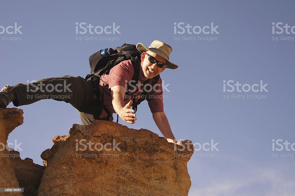 Hiker Reaching Out stock photo