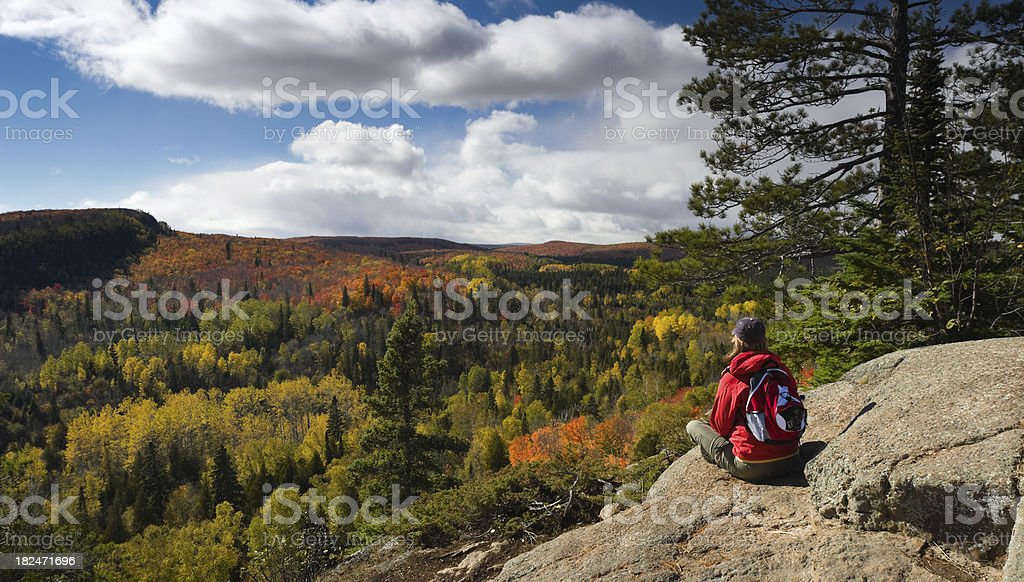 Hiker resting and taking in an Autumn view. stock photo