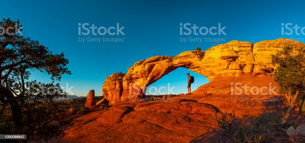 Hiker resting in Turret Arch stock photo