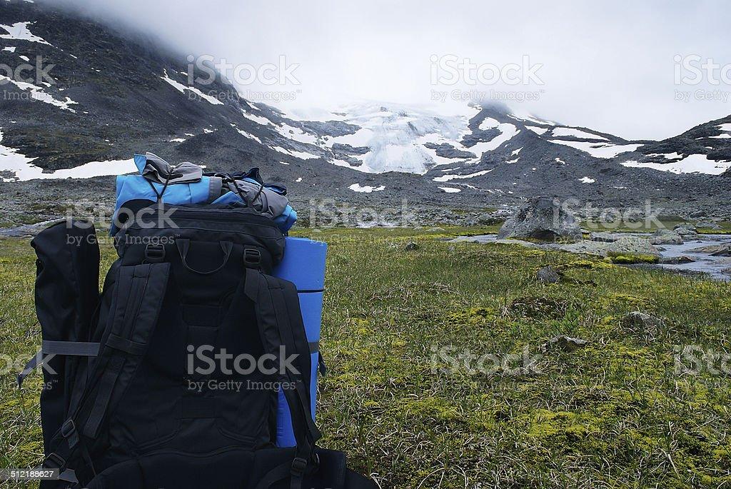 Hiker rucksack in front of glacier stock photo