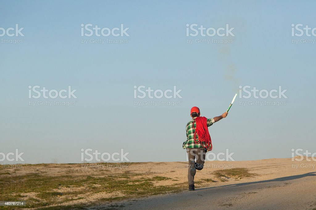 Hiker running with torch on dirt road stock photo