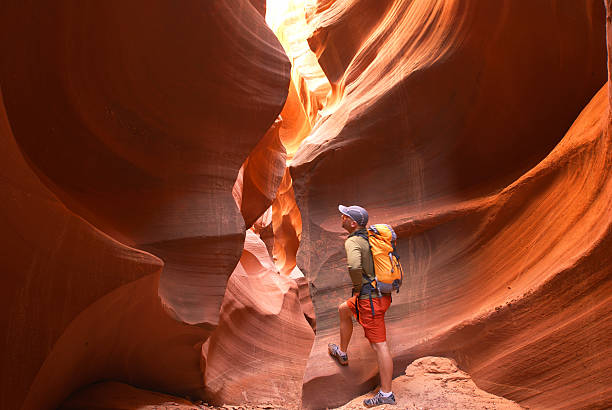 hiker sandstone desert slot canyon landscape stock photo