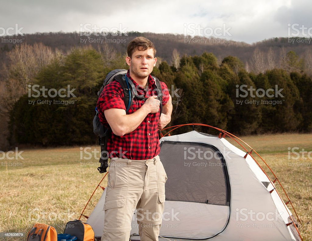 hiker sets up camp stock photo