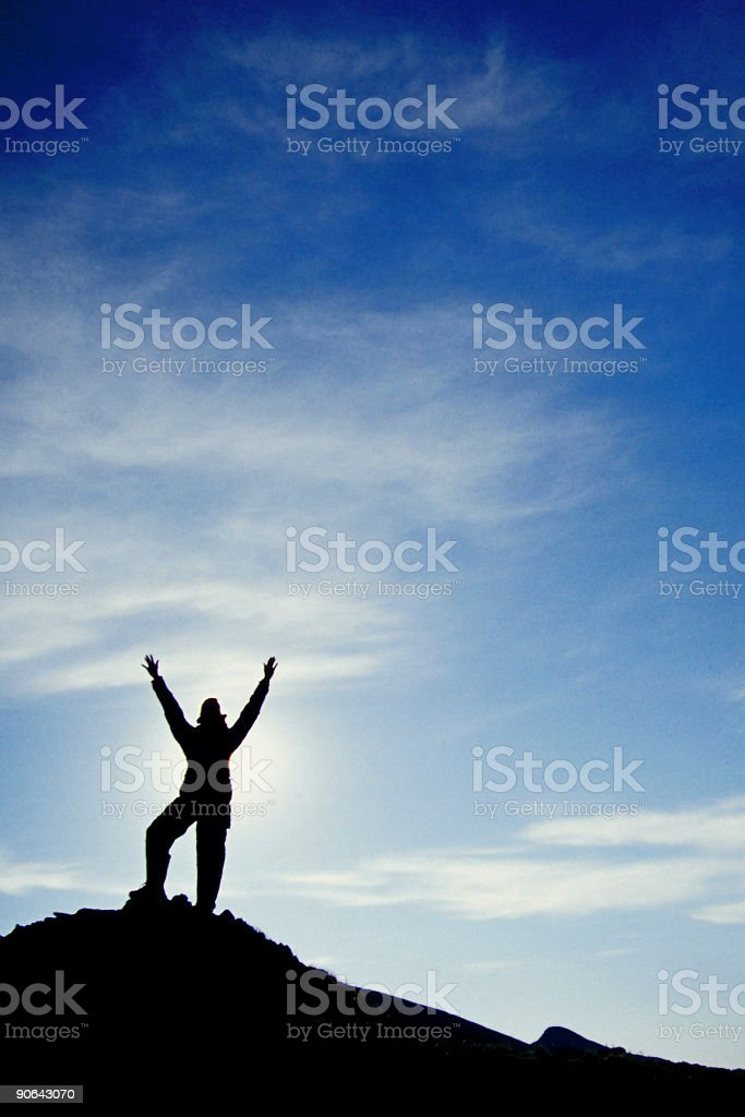 hiker silhouette arms raised big sky clouds landscape stock photo