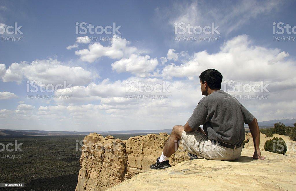 Hiker Sitting on Cliff stock photo