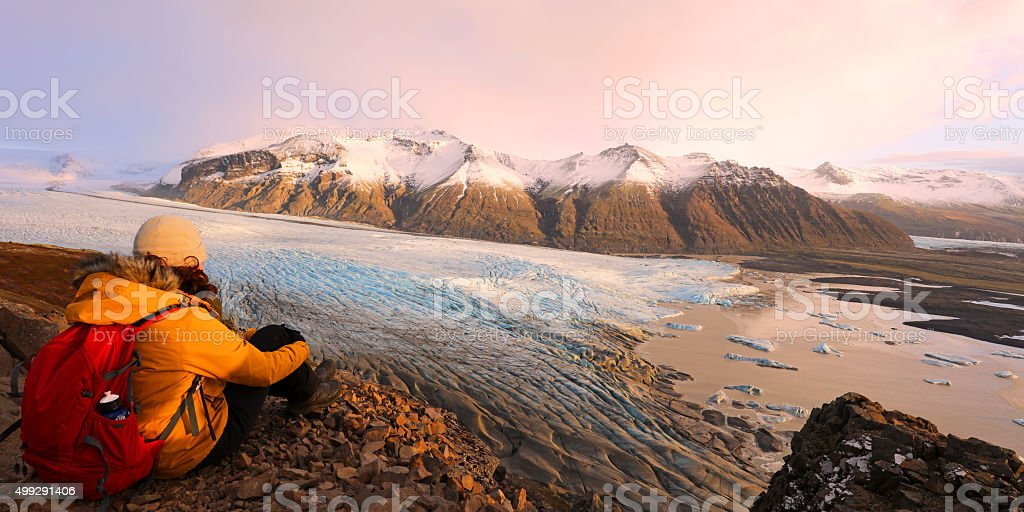 Hiker Sitting on Top of a Mountain Skaftafell NP Iceland stock photo