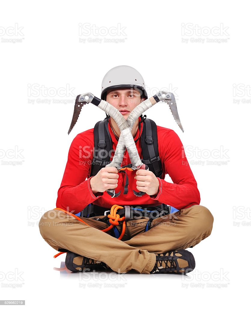 hiker sitting with ice axe stock photo
