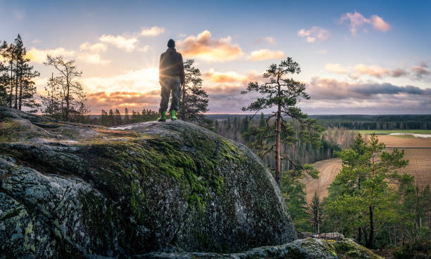 hiker standing front of beautiful landscape at early morning - finland stock pictures, royalty-free photos & images