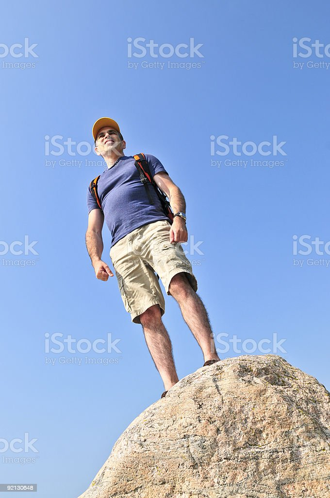 Hiker standing on a rock royalty-free stock photo