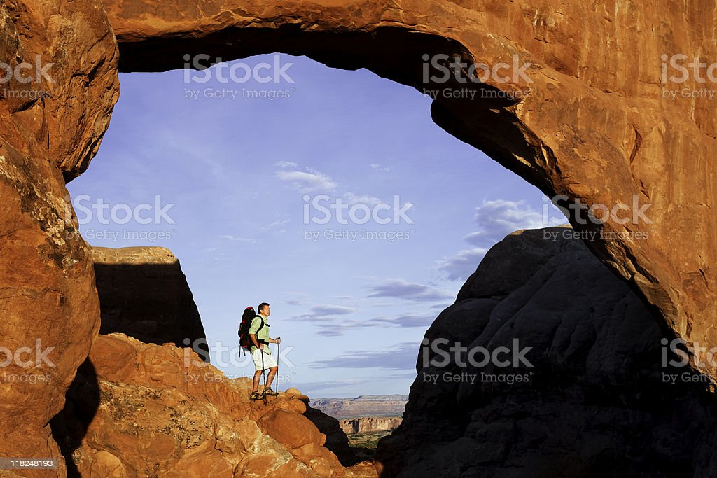 Hiker Standing On Rock Ledge In Arches National Park royalty-free stock photo