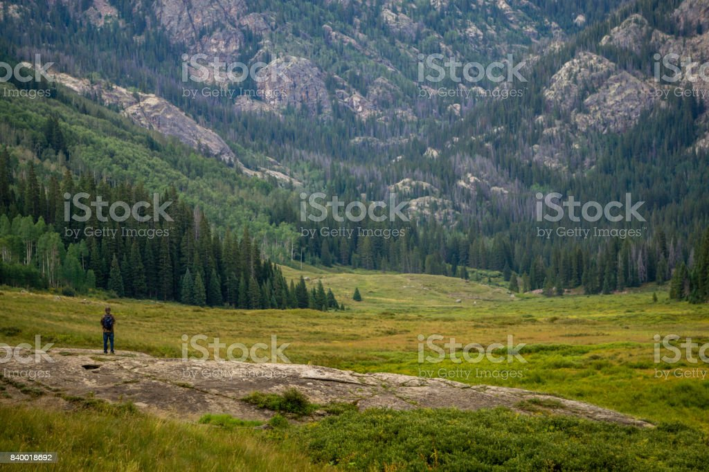 Hiker Stares Into Colorado Wilderness stock photo