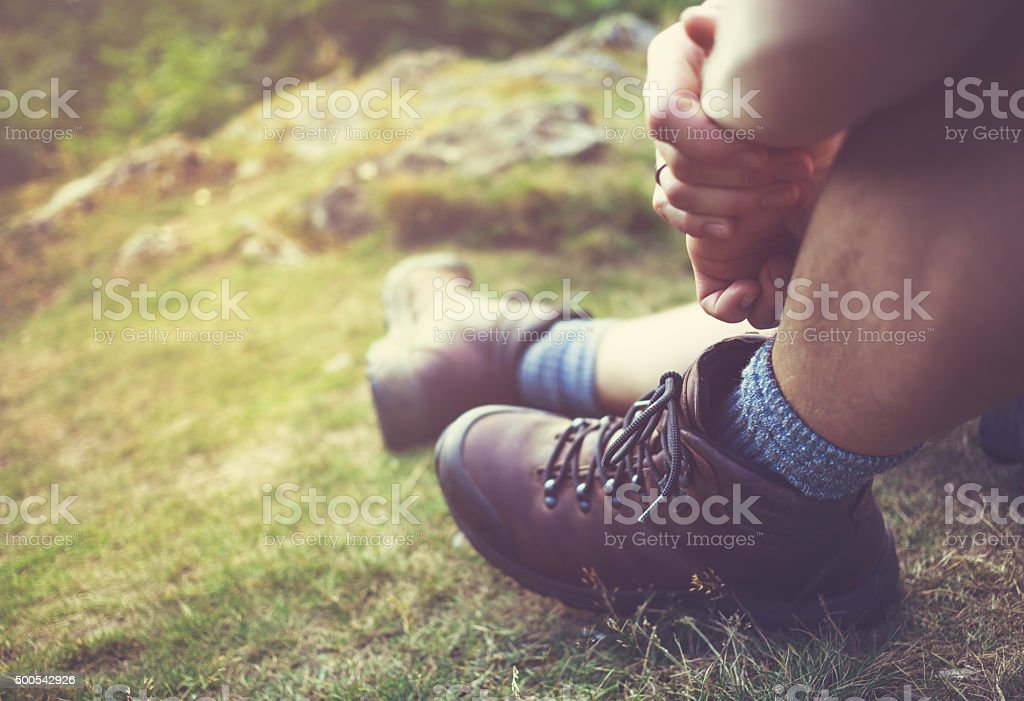 Hiker taking a rest in the Lake District - UK stock photo