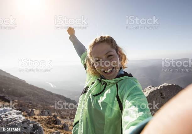 Hiker taking a selfie on the top of the hill picture id640317854?b=1&k=6&m=640317854&s=612x612&h=2zcvztx6nftkgsgdexohuzxwjqklhsh06vssnyxmr5e=